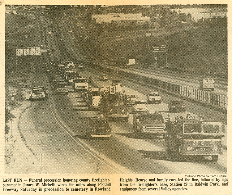 Image of a freeway with a long line of fire trucks