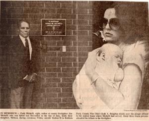 Newspaper photo of Chief Bragdon and Patti Michelli on the right